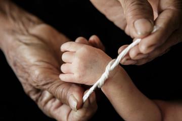 Grandma thread that tied the hands and pray, Lanna Thai Culture