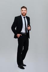 Full length smiling business man