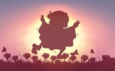 Silhouette boy running in garden