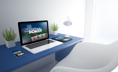 Wall Mural - blue responsive studio with poker website devices