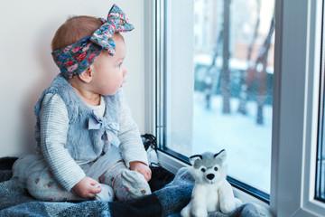 Child looks at snow