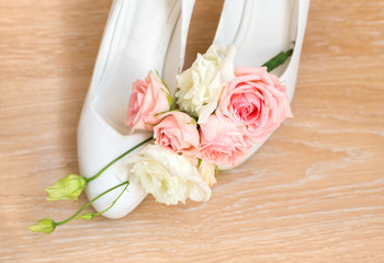 Wedding details, bride shoes and flowers