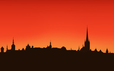 Tallinn city sunset skyline - dark outline against bright sky
