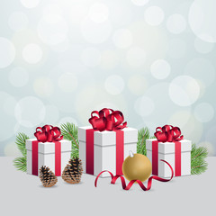 Glowing silver bokeh background and christmas gift boxes with decoration balls
