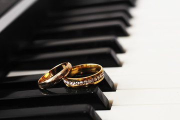 Wedding rings and piano