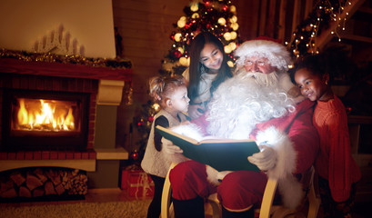 Santa Claus reading magic book with children.