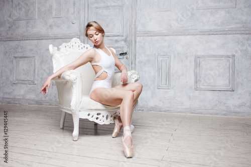 db549ae59 Young beautiful girl in white dance leotard and Pointe shoes