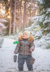 Child sleeding in winter snow fairy forest