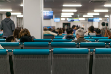Unidentified people waiting at the airplane boarding gates at airport