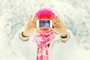 Winter photo hands woman taking photo self portrait on smartphon