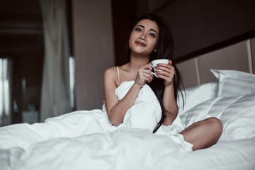 Portrait of a beautiful sensual asian woman with coffee