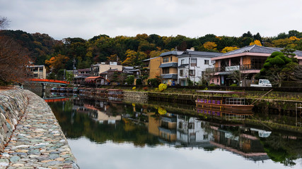 Uji river with cityscape at autumn, Kyoto