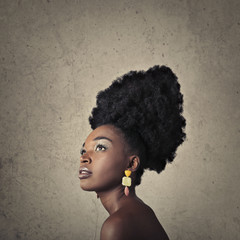 Beautiful black woman wearing earrings