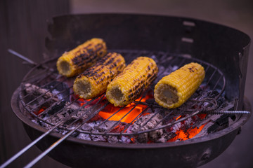 Grilled corn on hot coals