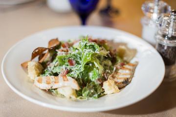Salad with chicken and croutons. Caesar