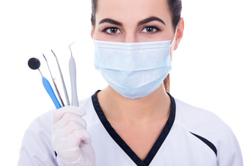 close up of dentist woman in mask with tools isolated on white