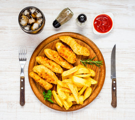 Fast Food with French Fries, Cola and Chicken Nuggets