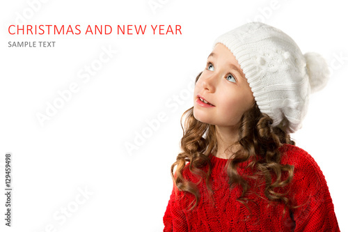 05ee0254a Cute little girl in winter clothes on isolated white background ...