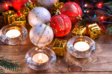 Christmas balls, gift boxes and candles
