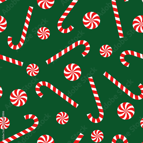 candy cane and lollipop seamless christmas pattern on green background happy new year and merry