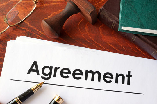 Agreement form on an office table.