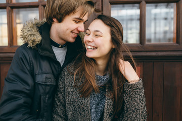 Beautiful young adult couple posing at camera