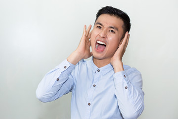 Closeup of Serious Young Asian Man Shouting Loud