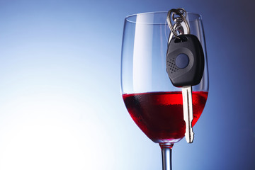 car key hanging at wine glass