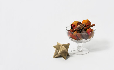 Fall theme, conceptual image. Low poly star beside glass vase.