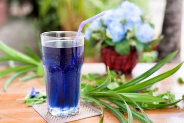 pea flowers healthy drink on wood table