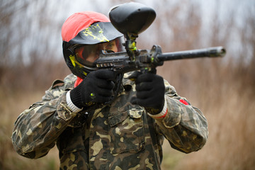 Paintball sport player wearing protective mask