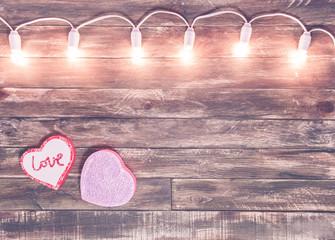 valentine wooden textured background with light garland