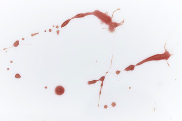 Documentation and research of blood stains on white plastic background