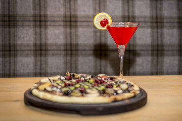 Red cocktail and the sweet pizza - Stock image