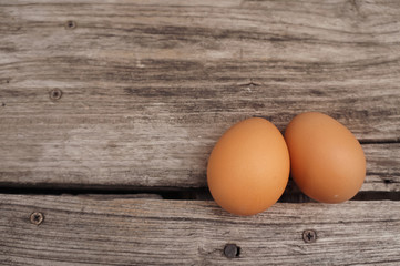 Brown eggs on a old wood table