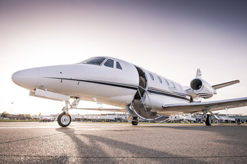 Private jet ready for boarding/Luxury business jet with open door ready for passenger boarding