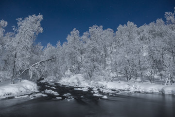 Frozen river and snow covered trees, Finland