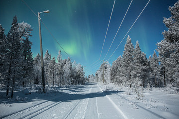 Northern lights and road, Finland