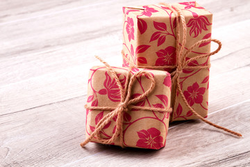 Boxes wrapped in gift paper. Presents and bows from rope. Lovely packages for gifts. Great ideas for presents decoration.
