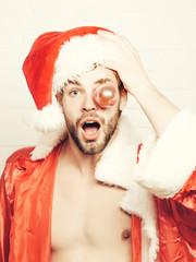 handsome muscular christmas santa man