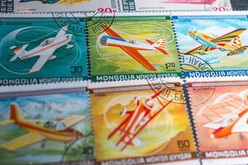 Philately. Postage stamps in album. Background on postage stamps