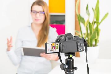 Video camera blog recording. Vlog blogger woman.