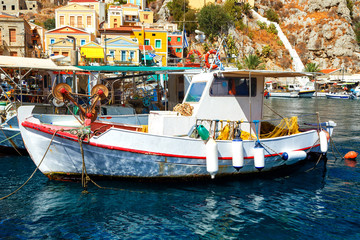 Symi island - Colorful houses and small boats at heart of village