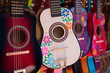 Display of ornate, small Mexican made guitars