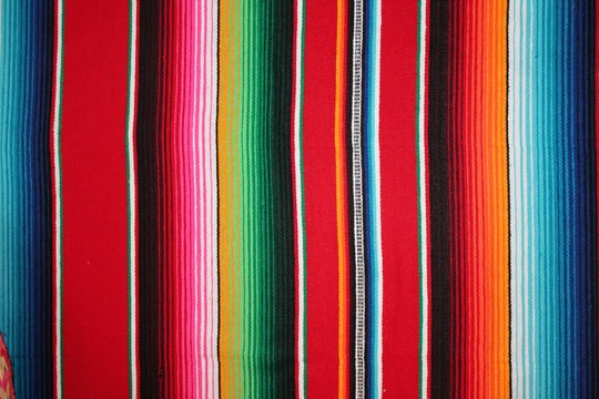 mexican poncho background serape Mexican cinco de mayo Mexico rug poncho fiesta with stripes backdrop stock photo, stock photograph, image, picture