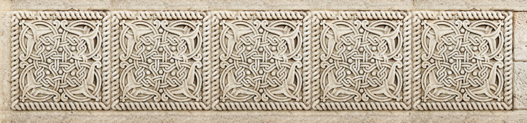 Closeup of architectural ornament. Stone carving of flower motif