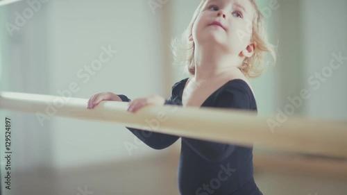 a7e1fdcedeac Girl dancer in ballet school learns to dance. A teacher at the ...
