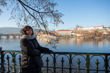 Beautiful Woman in Prague embankment on river Vltava