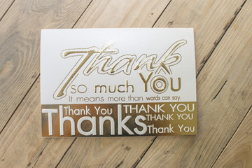 Thank you card on wooden background