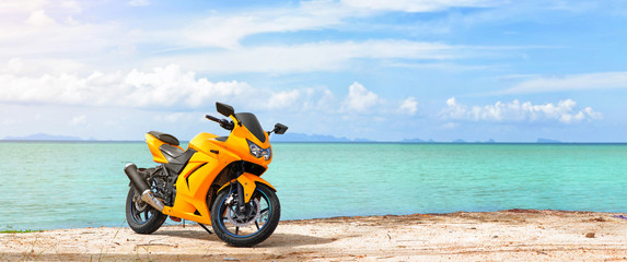 Foto auf Acrylglas Motorsport Panoramic scene of sport motorcycle at the beach